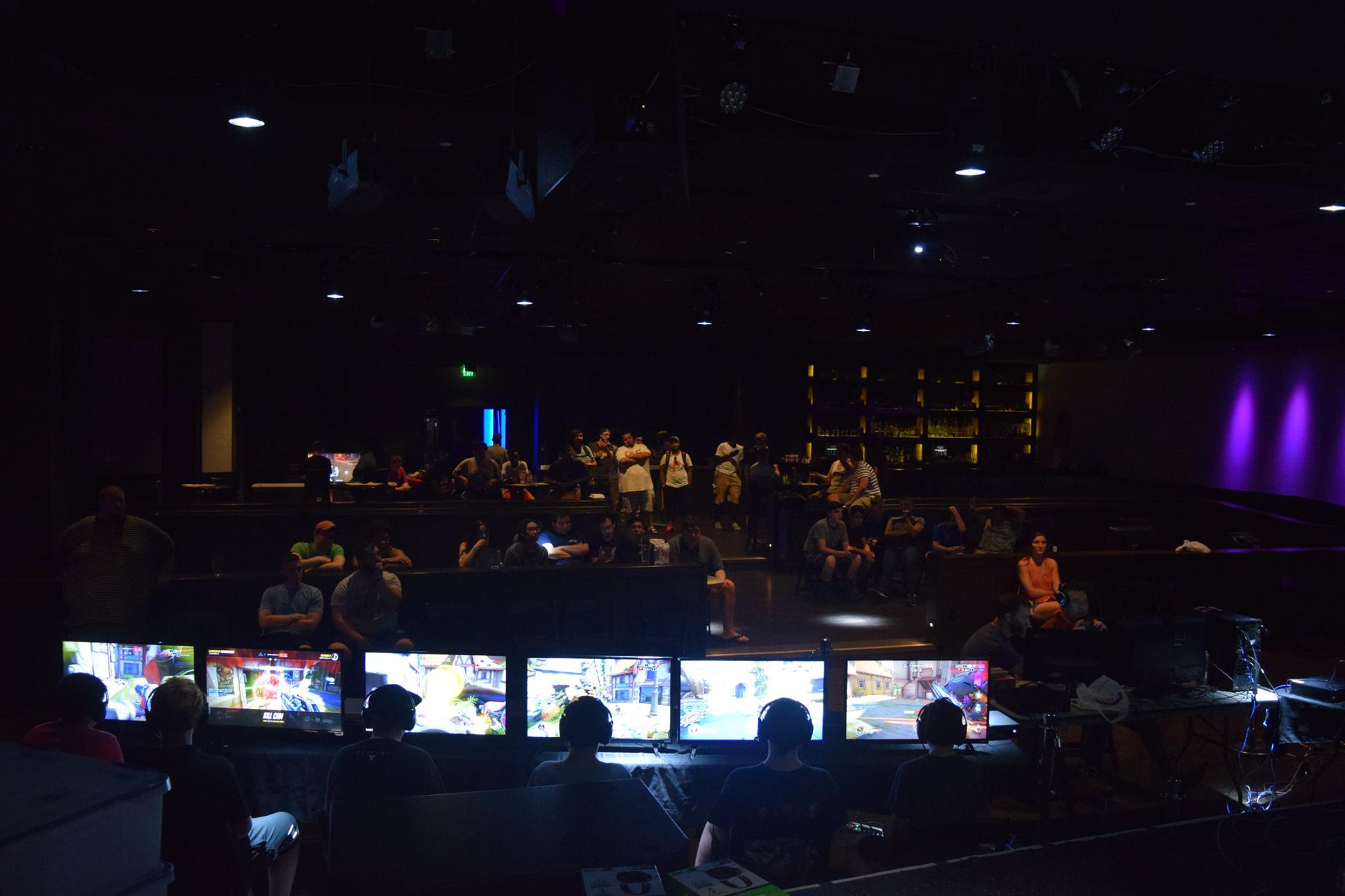 ClaimtoFameEntertainment-esports competitors in dark large room
